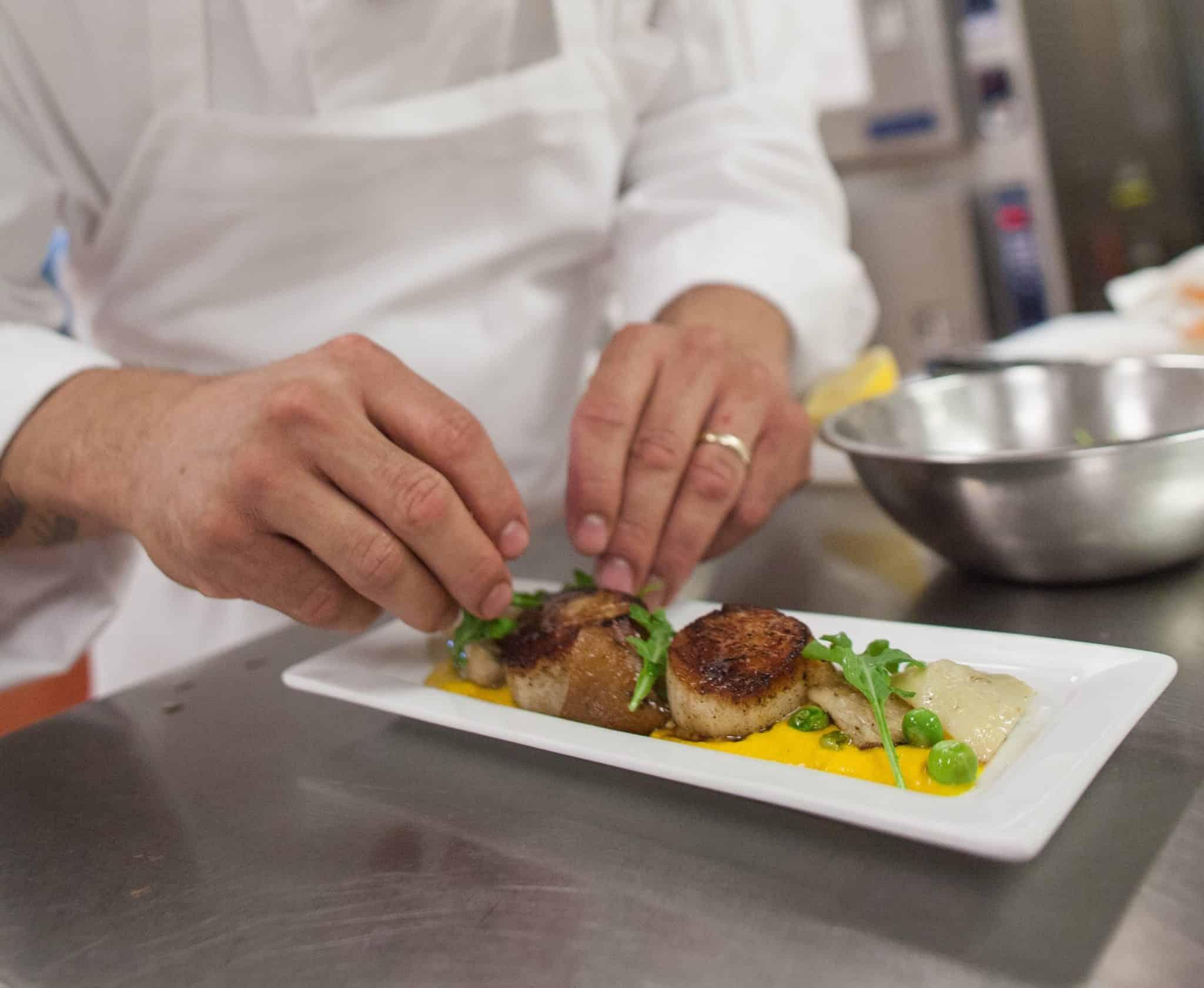 Judson chef prepared seared scallop entre.
